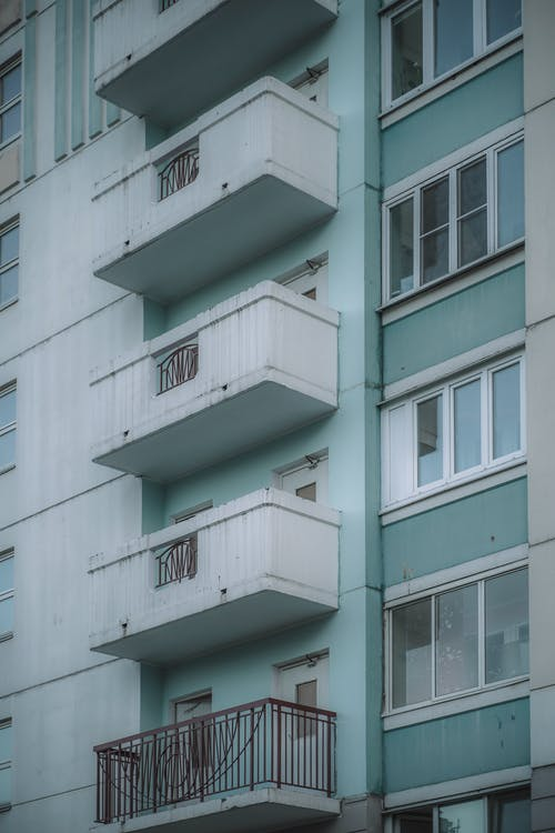 Close-Up Photo of a White and Green Building