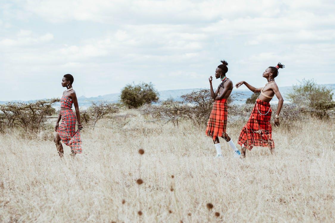 Photo of People Walking on Grassland