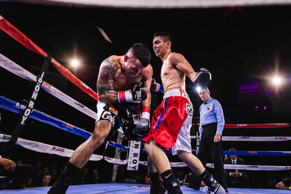 Low-Angle Photo of Two Men Fighting in Boxing Ring