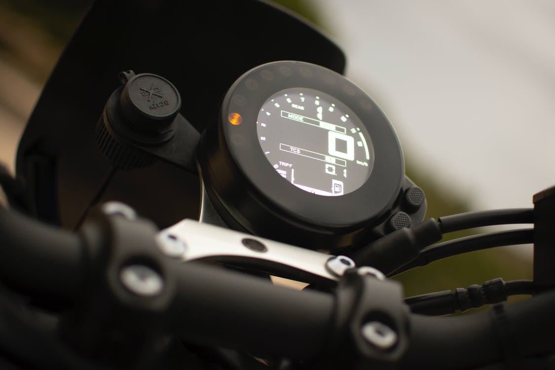 Close-Up Photo of Motorcycle's Speedometer