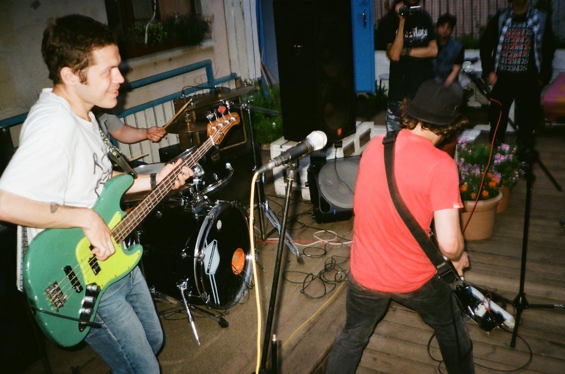 Two Men Playing Electric Guitars