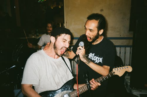 Photo of Two Men Singing