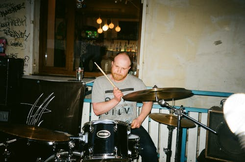Man in Gray T-shirt Playing Drums