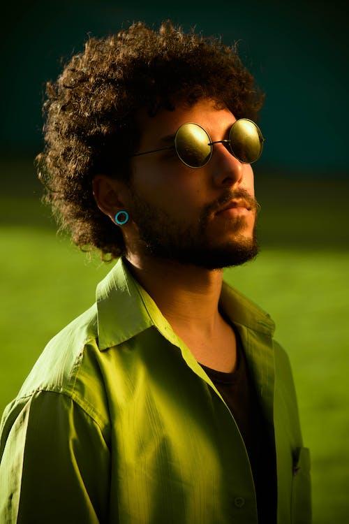 Photo of Man Wearing Sunglasses