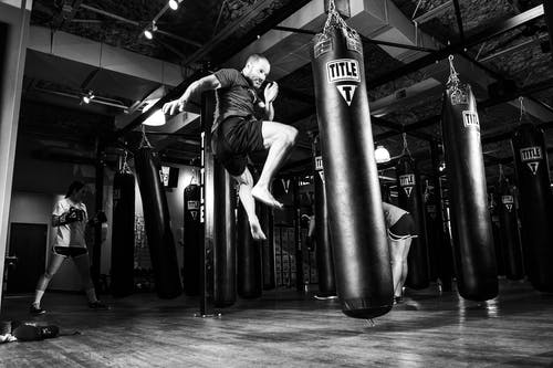 Man Kicking Heavy Bag