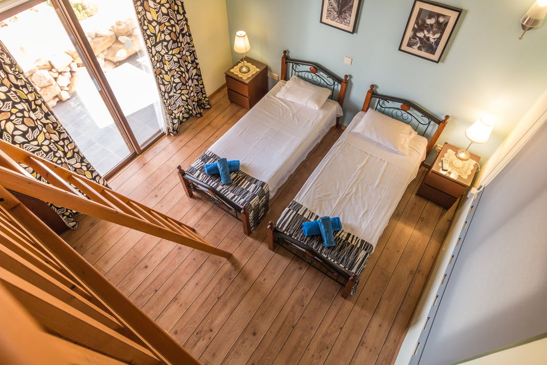 Two Beds in Room Beside Ladder