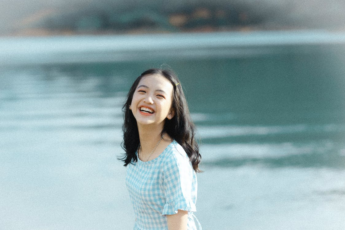 Shallow Focus Photo of Girl Smiling