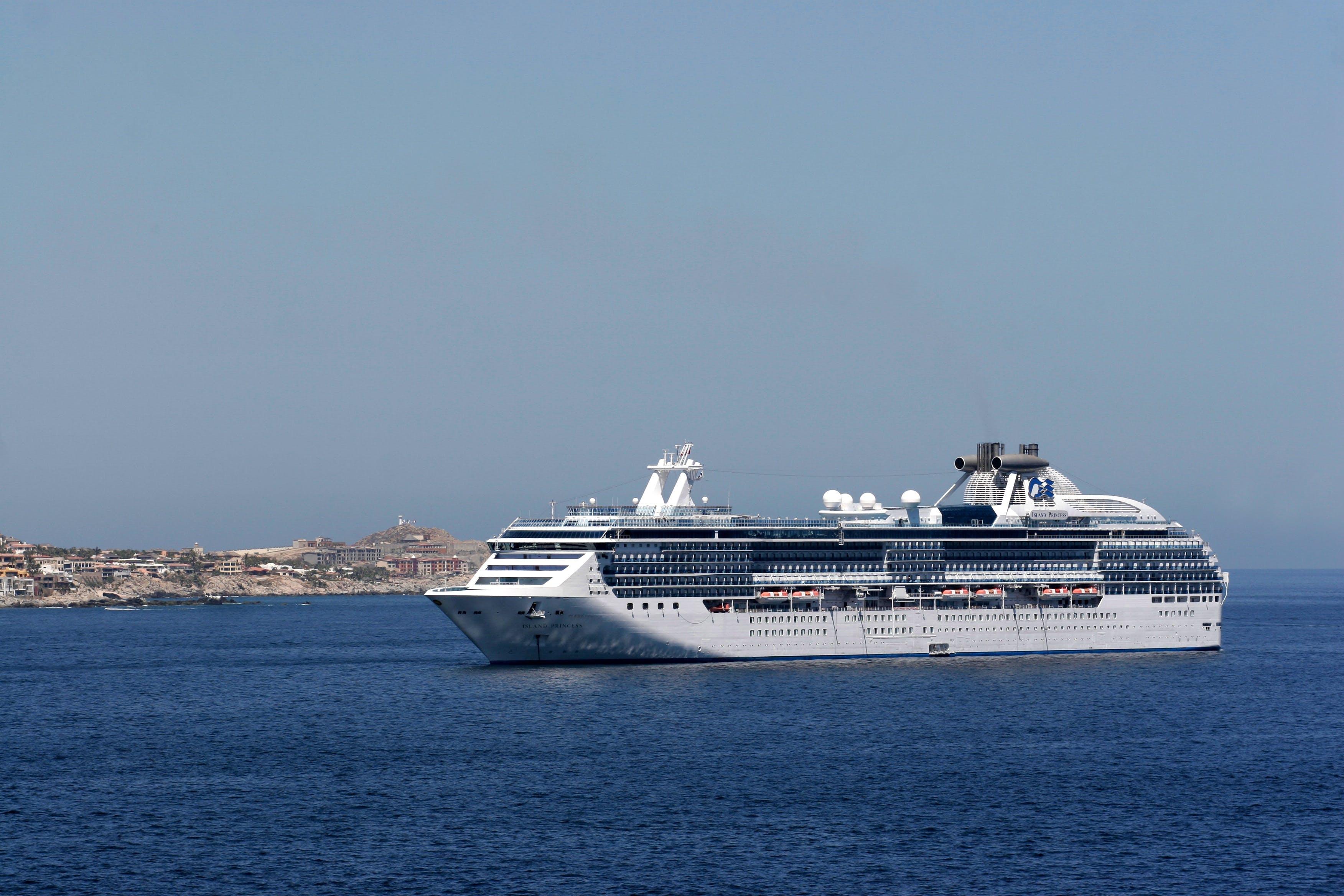 White Cruise Ship Sailing on Sea