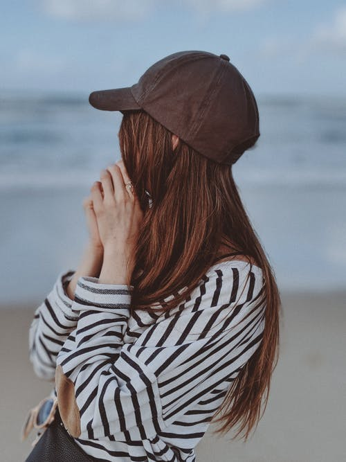 Shallow Focus Photo of Woman Wearing Striped Long Sleeves