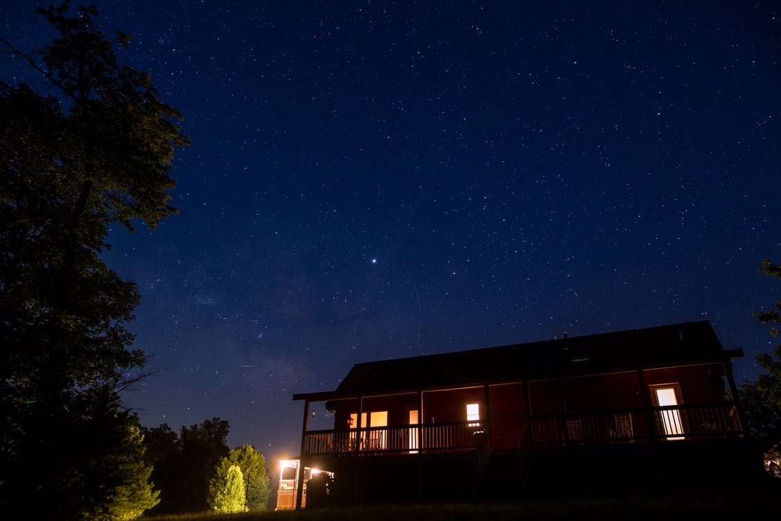 Photo of Lighted House Under Starry Night Sky