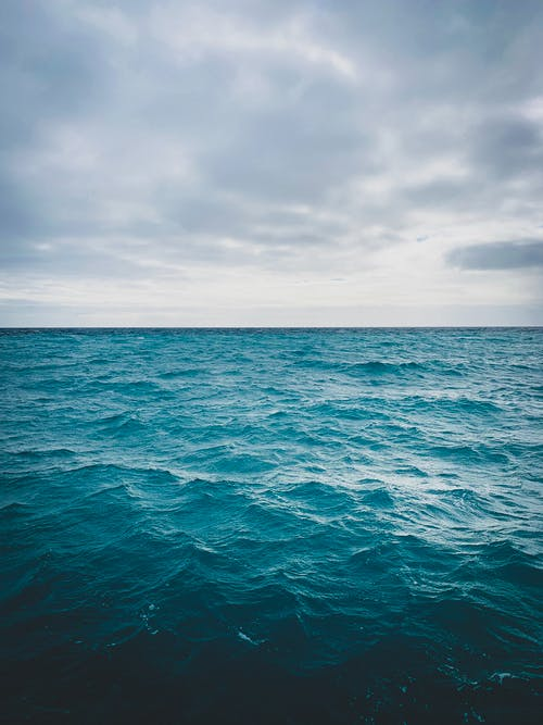 Photo of Ocean Under Cloudy Sky