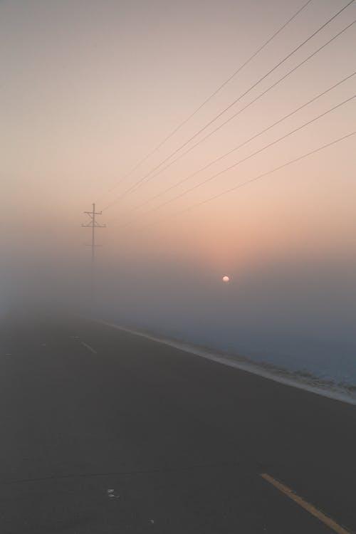 Gratis lagerfoto af solopgang, t¨åge, vej