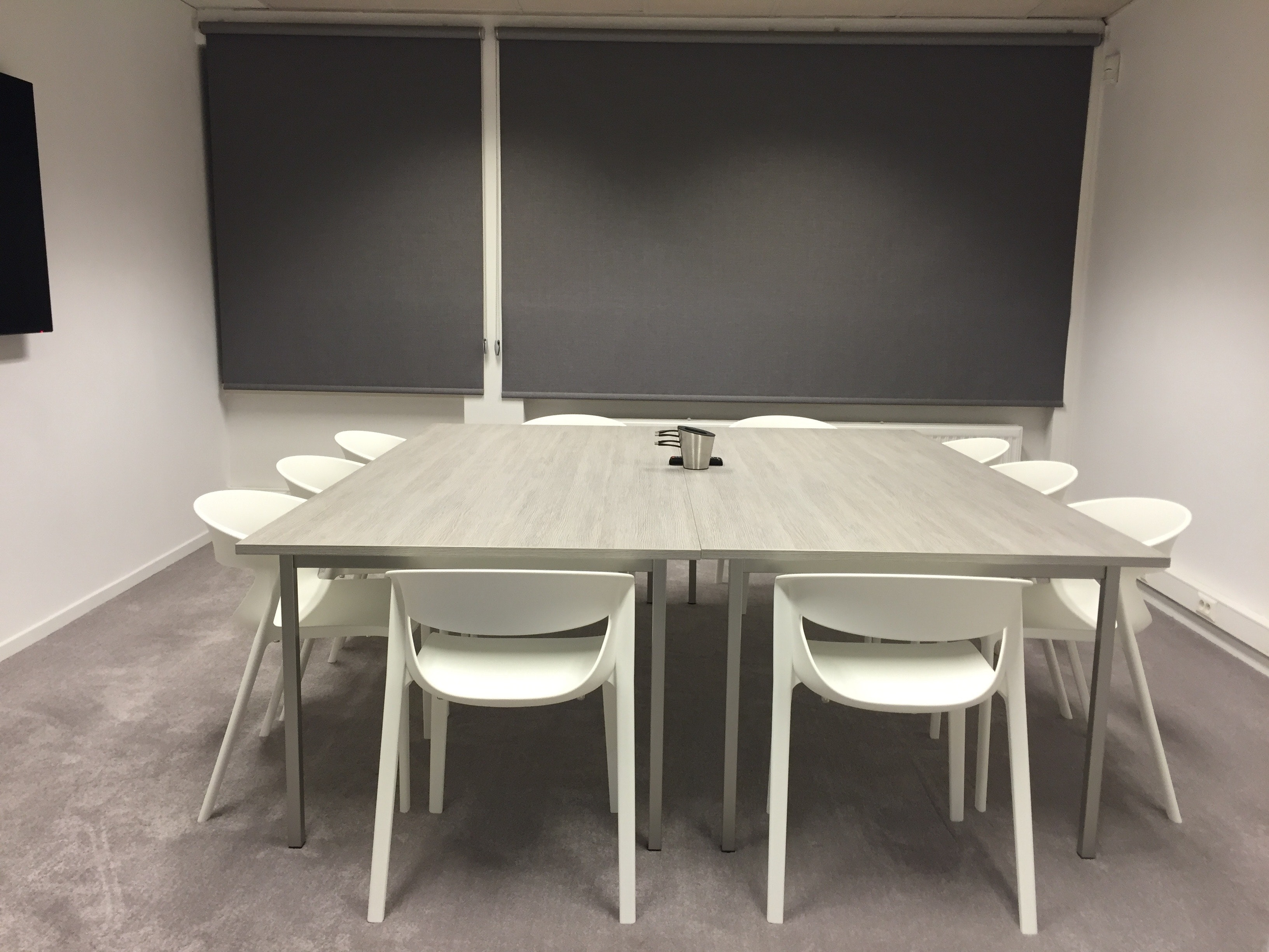 rectangular white table with rolling chairs inside room  u00b7 free stock photo