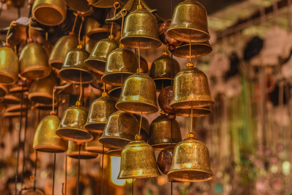Close-Up Photo of Brass Bells