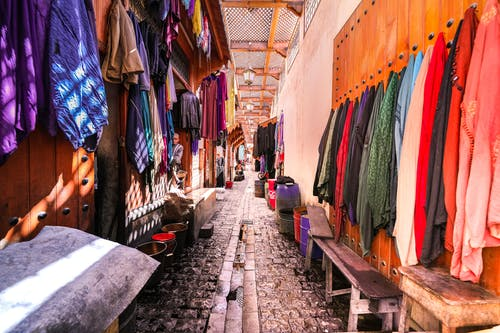 Assorted-color Clothes Hanged on Wall