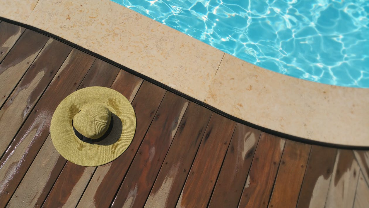 Brown Sunhat Near Swimming Pool