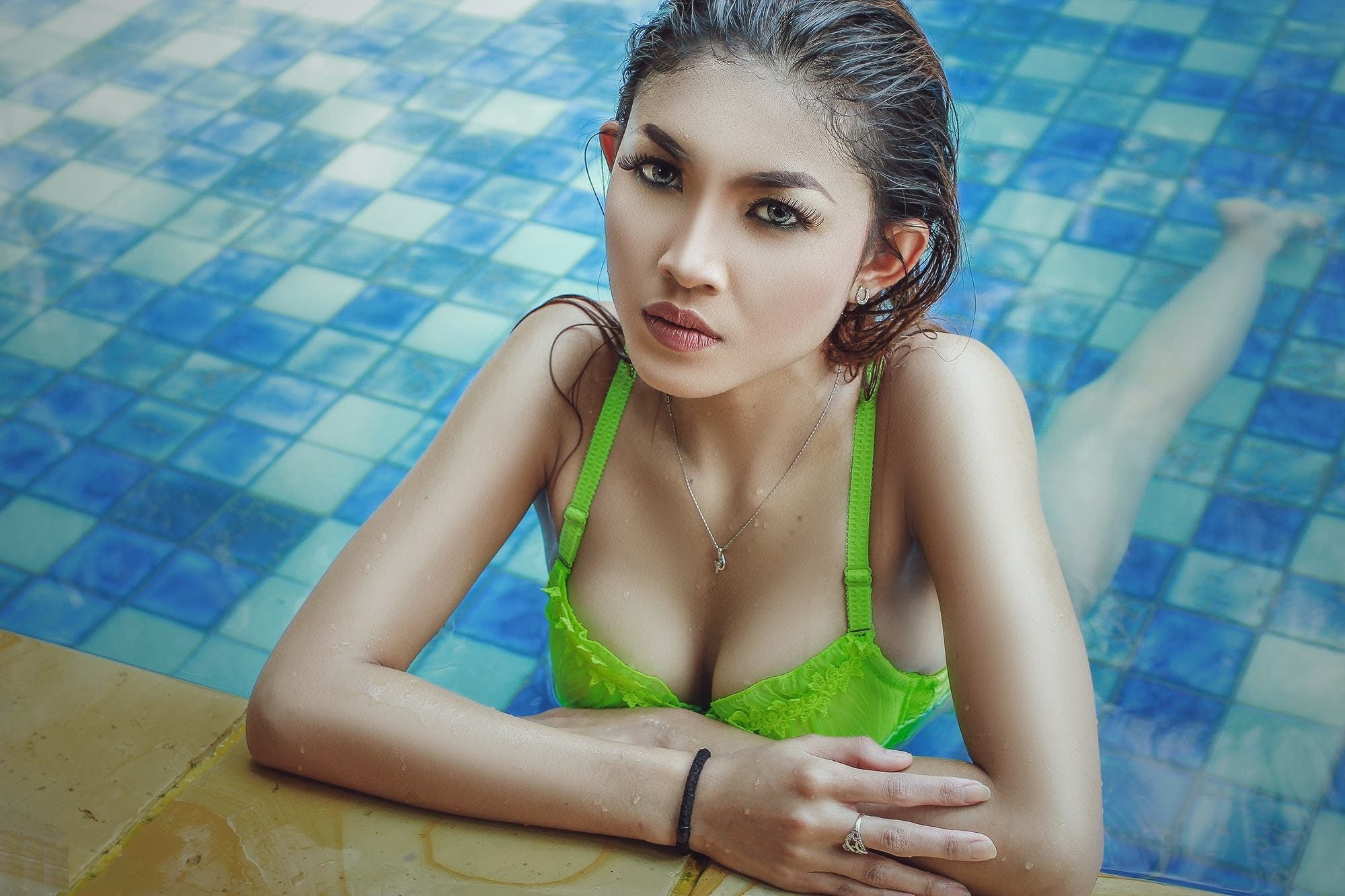 Woman Wearing Green Bra in Pool