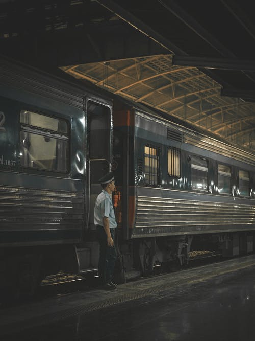 Train Personnel Standing Beside Train