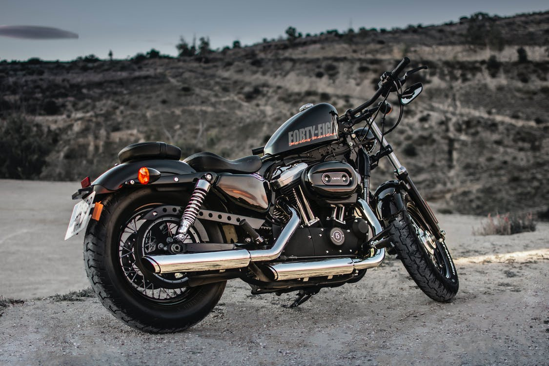 Photo of Black Harley Davidson Forty-Eight 1200 Motorcycle Parked on Gravel Road