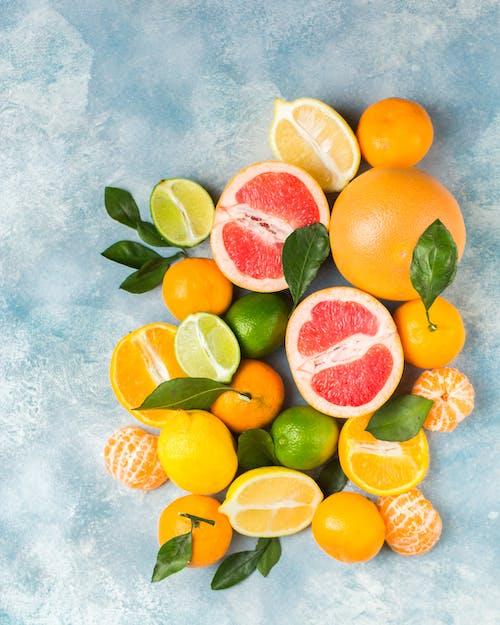 Безкоштовне стокове фото на тему «апельсин, апельсини, Асорті, великий план»