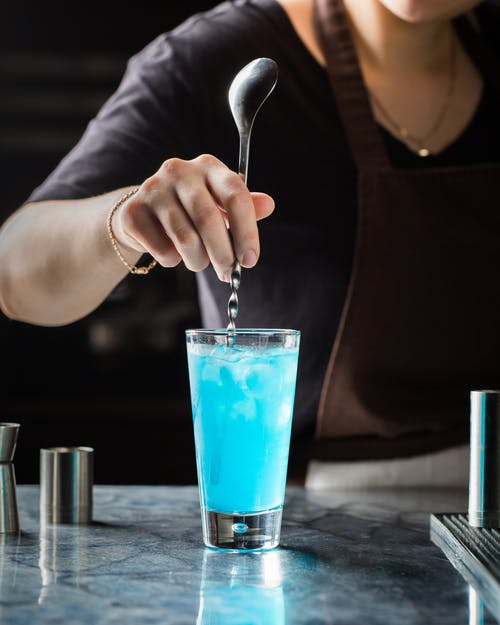 Person Mixing Drink