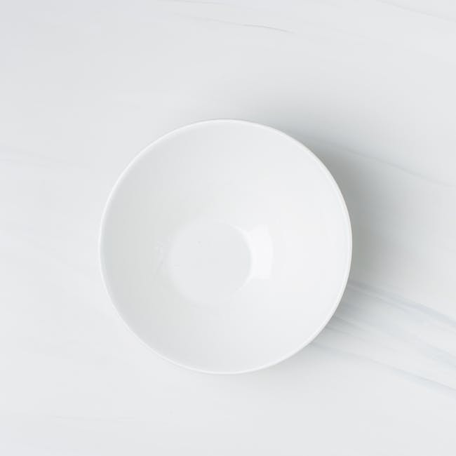 Flatlay photography of white ceramic bowl