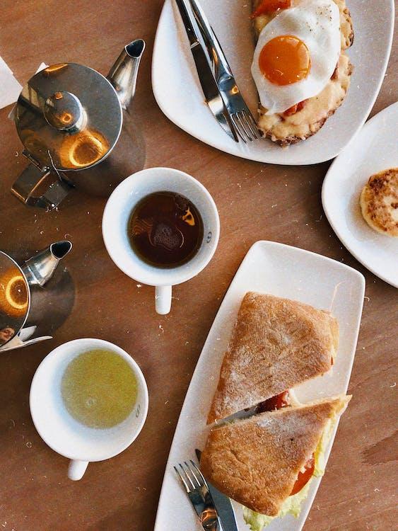 Flat Lay Photo of Breakfast Sandwich on Plate