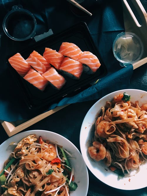 Top View Photo of Sushi and Cooked Noodles