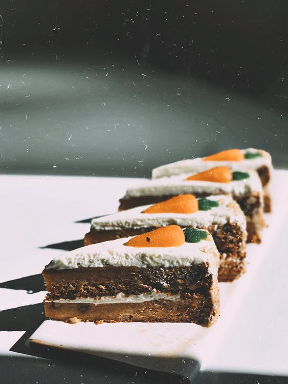 Photo of Four Sliced Carrot Cakes