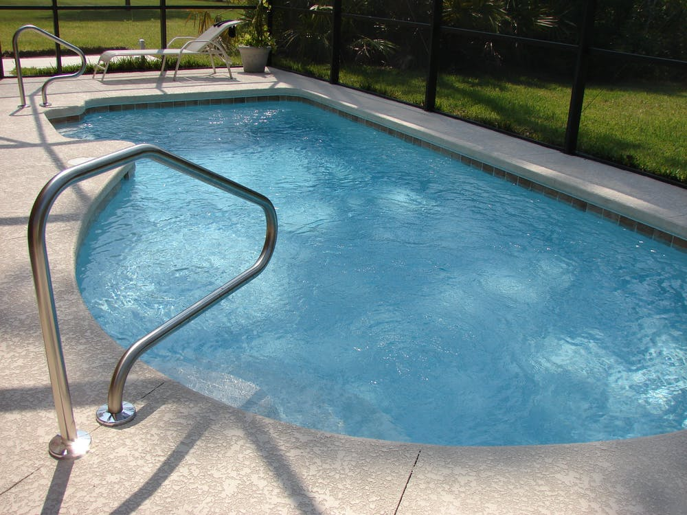 Swimming pool and fence surrounding