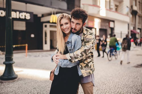 Photo of Man Hugging A Woman
