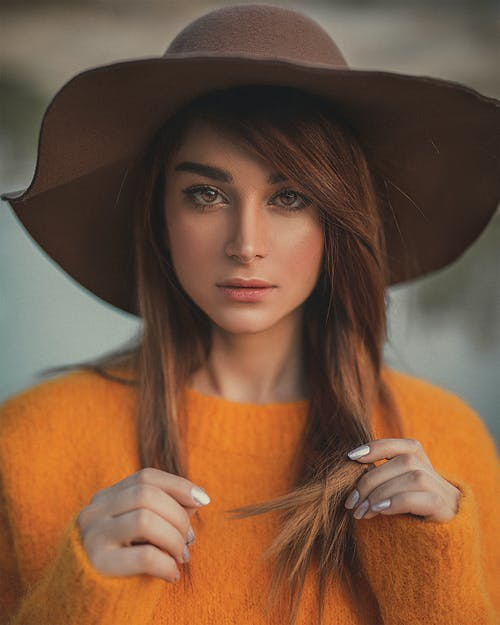 Woman Wearing Orange Sweater