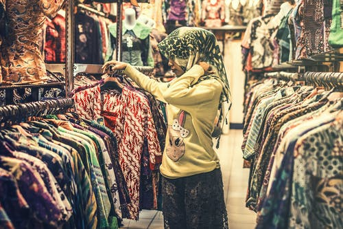 Photo of a Woman Inside a Clothing Store