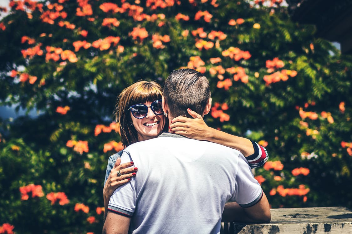 Photo of Woman and Man Hugging Each Other