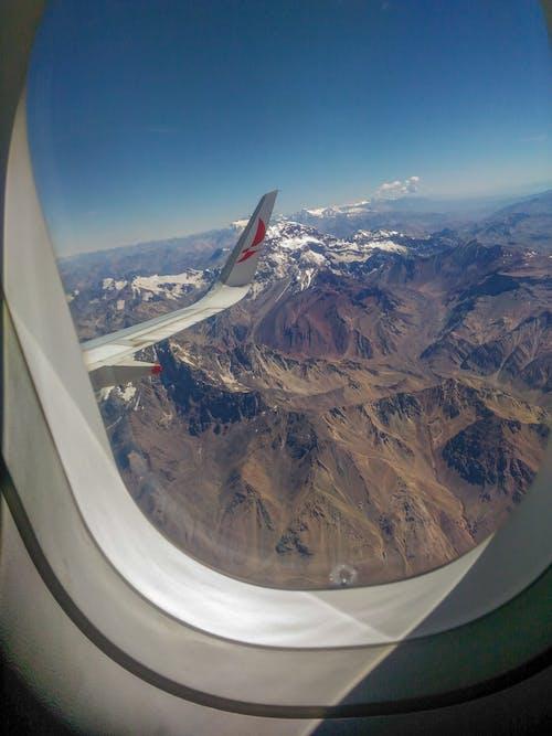 Free stock photo of aeroplane, aircraft wing, heaven, mountains