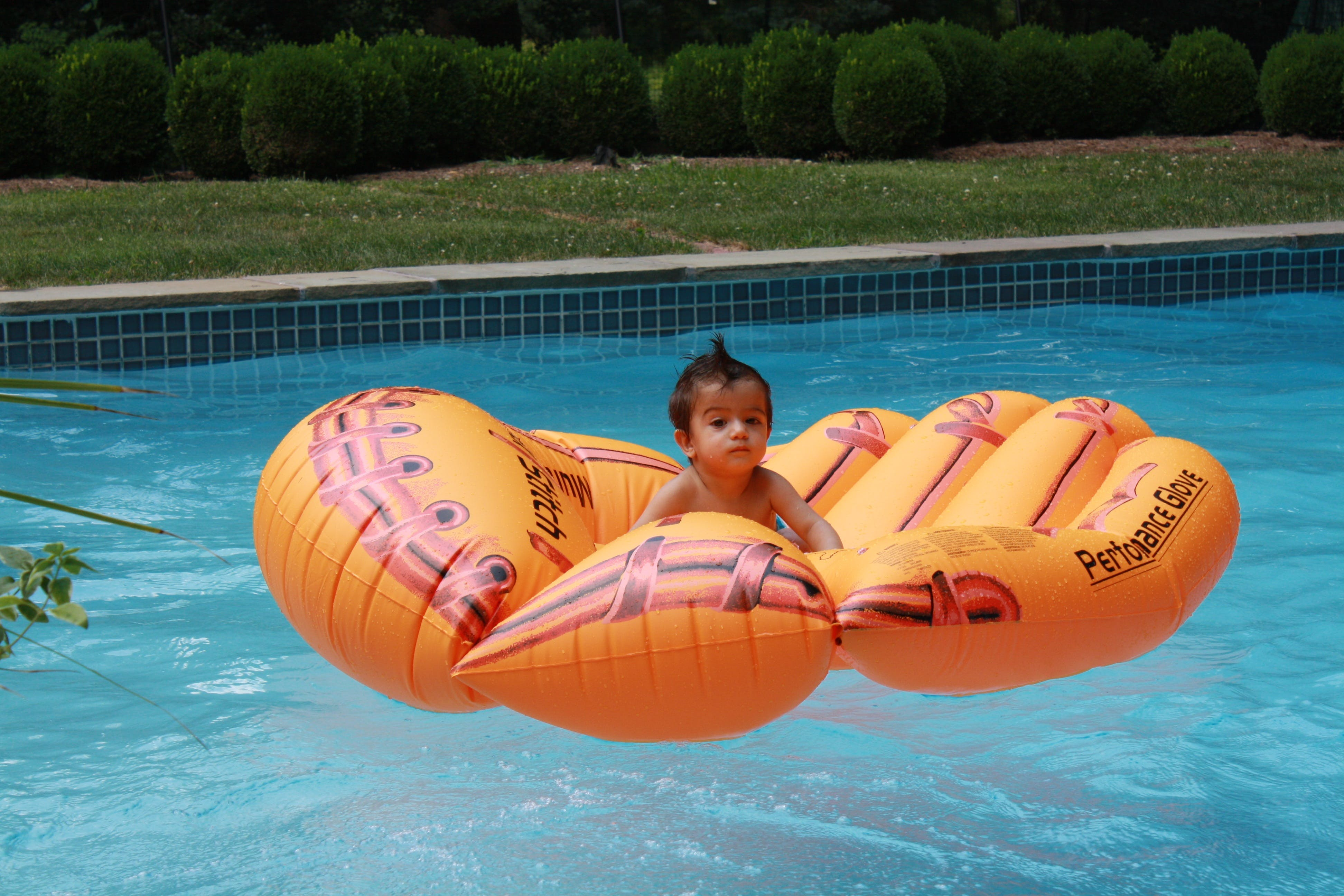 Free stock photo of baby, inflatable mattress, mohawk, pool
