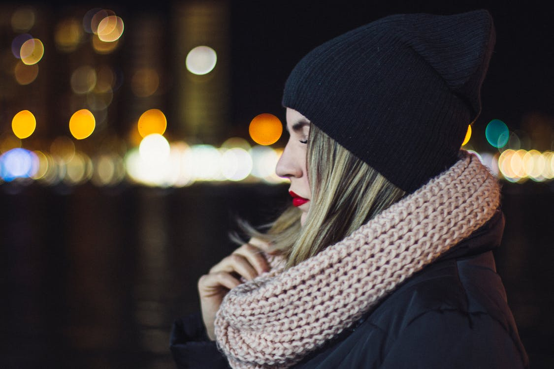 Woman Wearing Brown Knitted Scarf