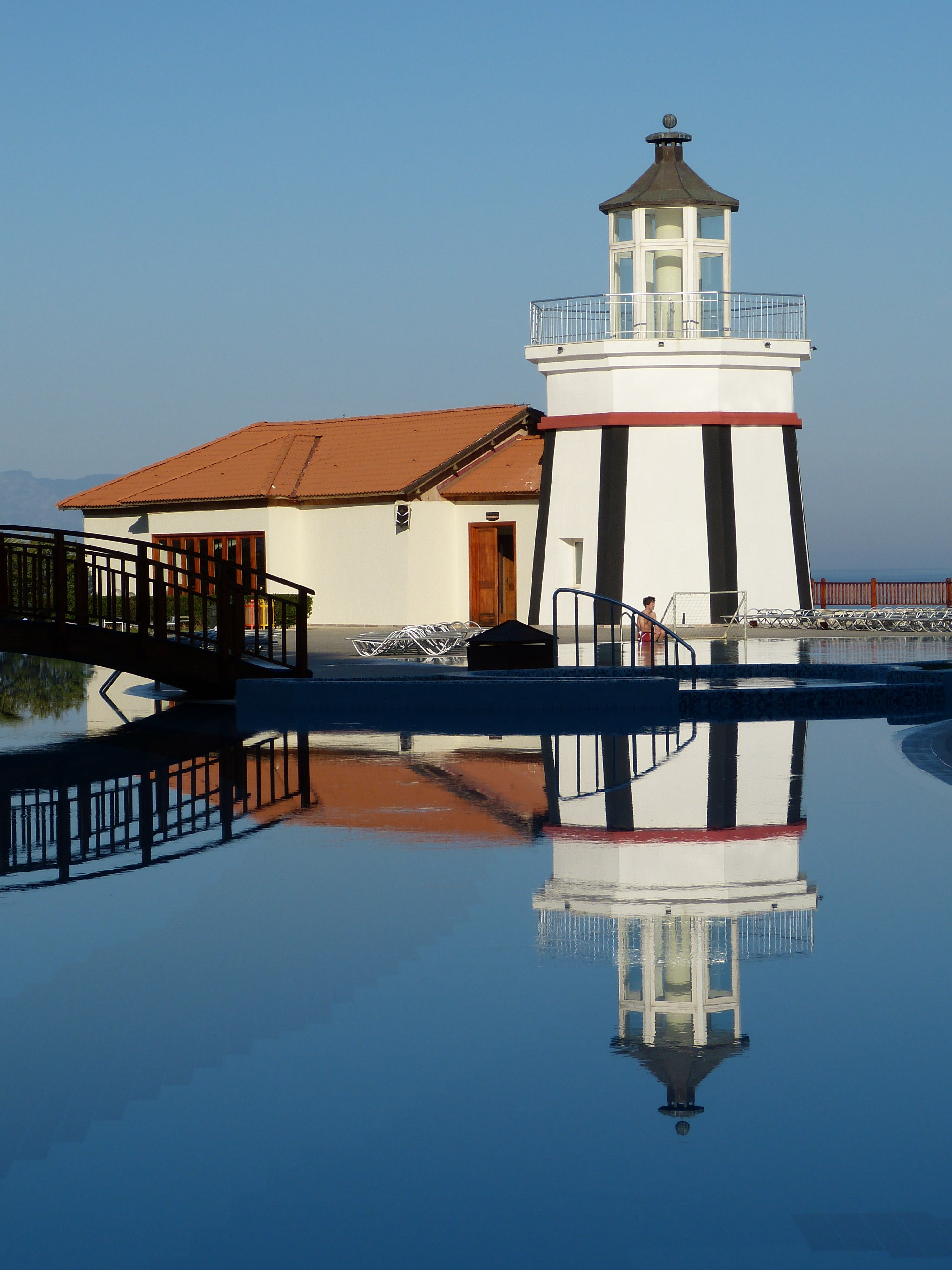 Lighthouse in Front of Swimming Pool