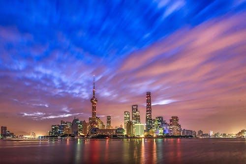 Ingyenes stockfotó alkonyat, belváros, épületek, felhőkarcolók témában
