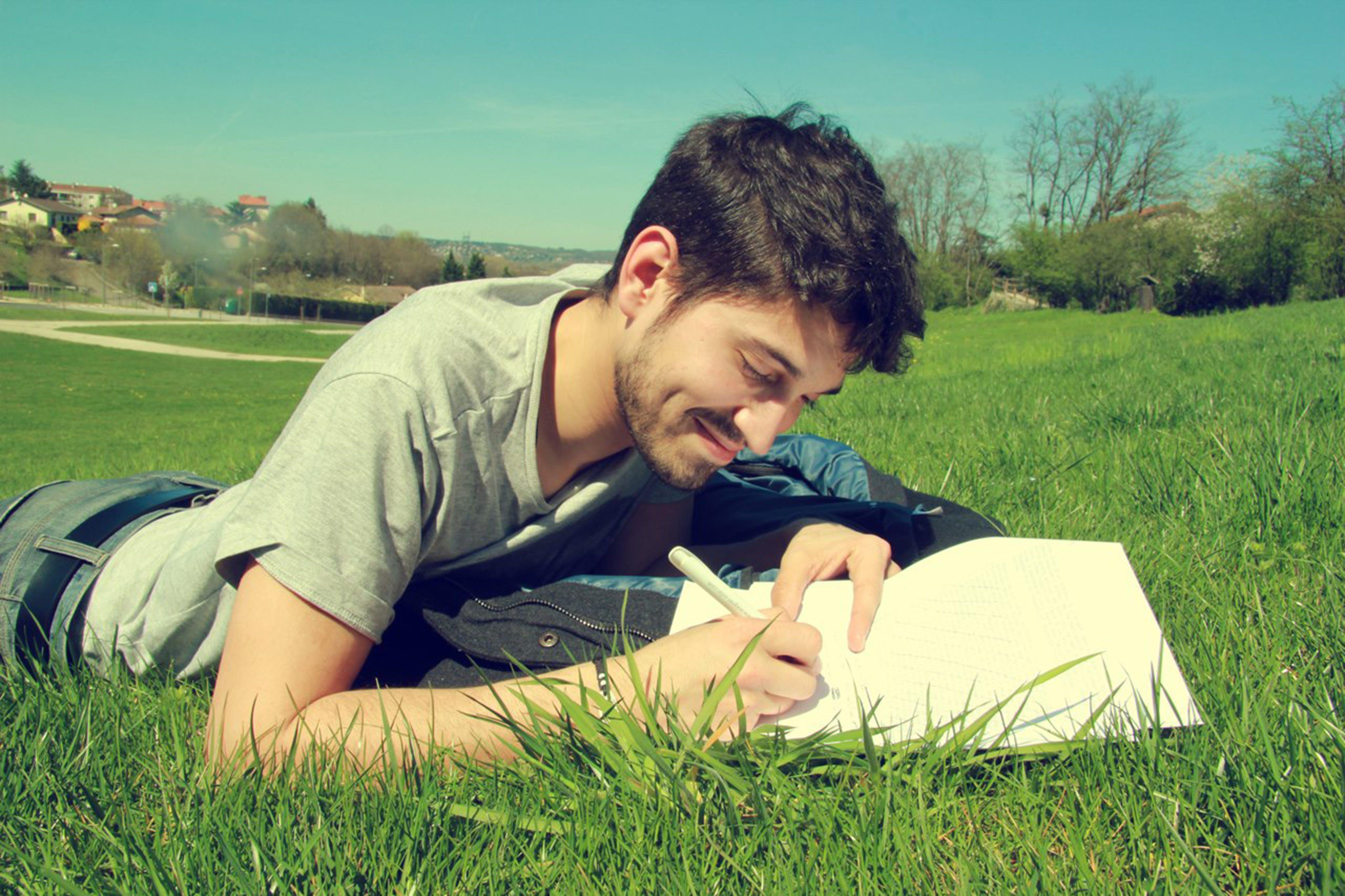 Man Writing on Book