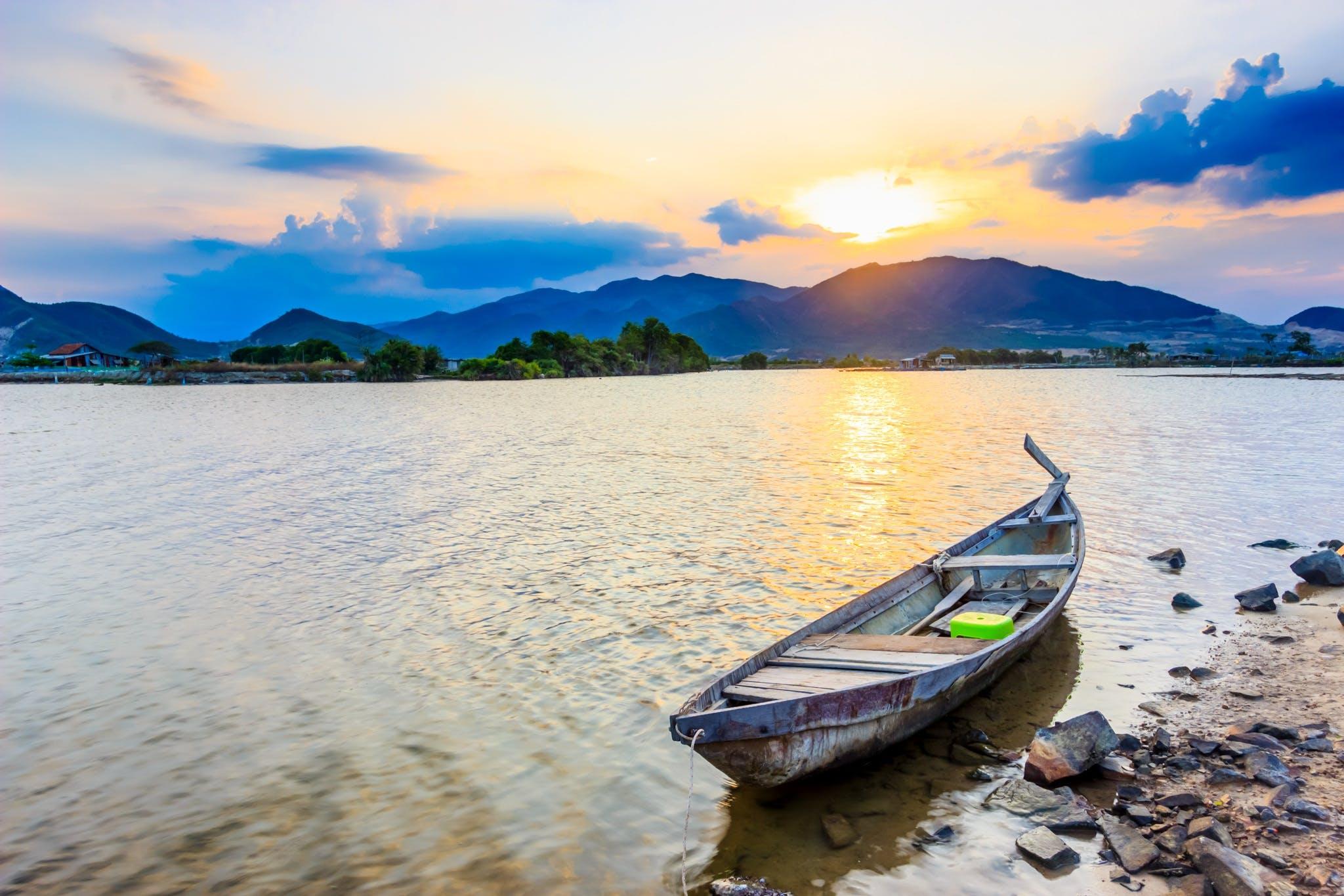 Gray Rowboat on Seashore
