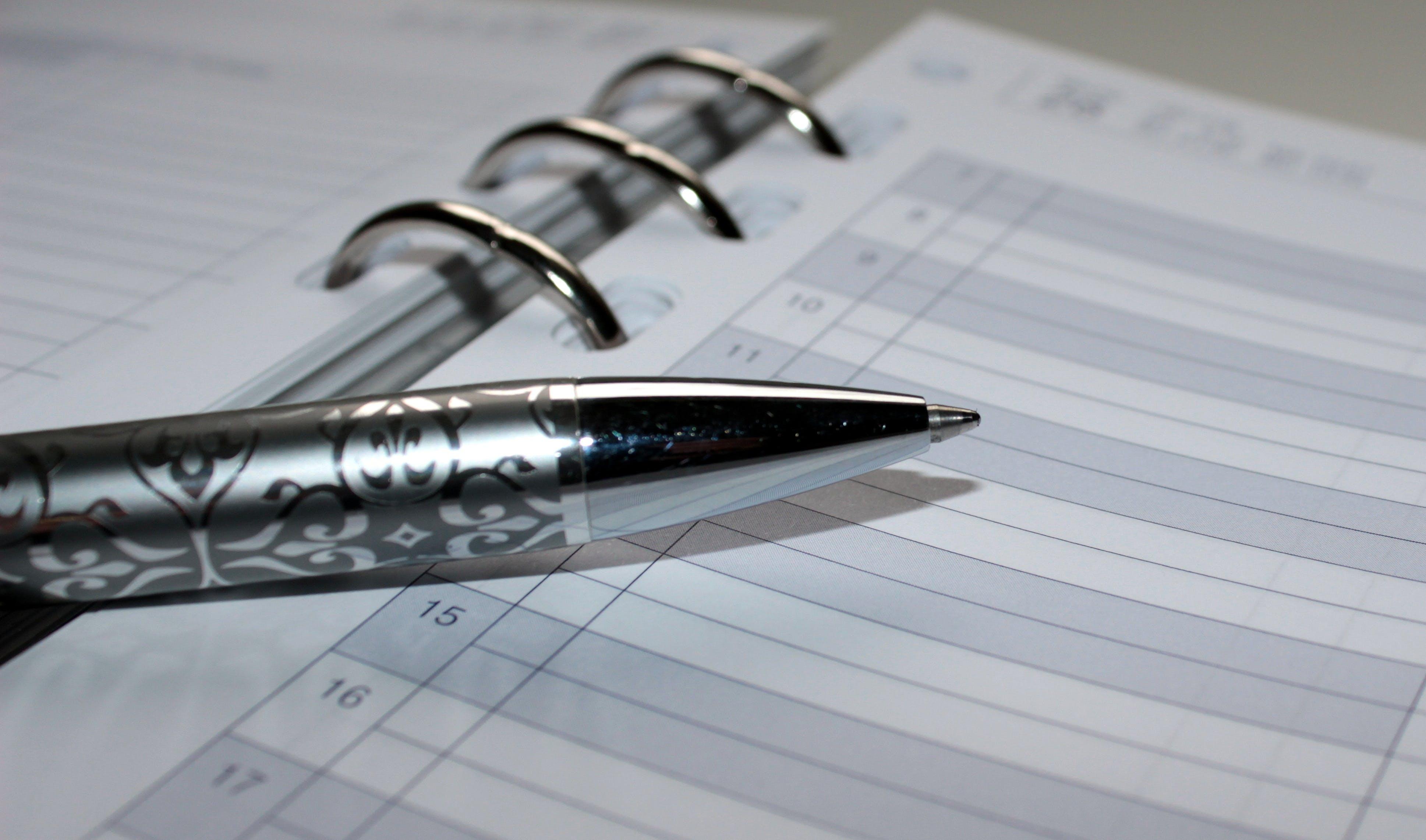 Gray Pen on Notebook