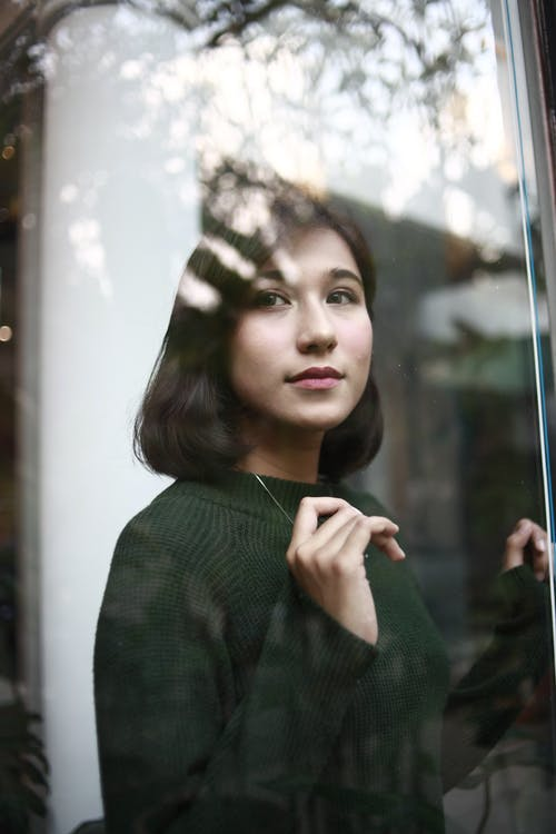 Photo of Woman Wearing Dark Green Sweater