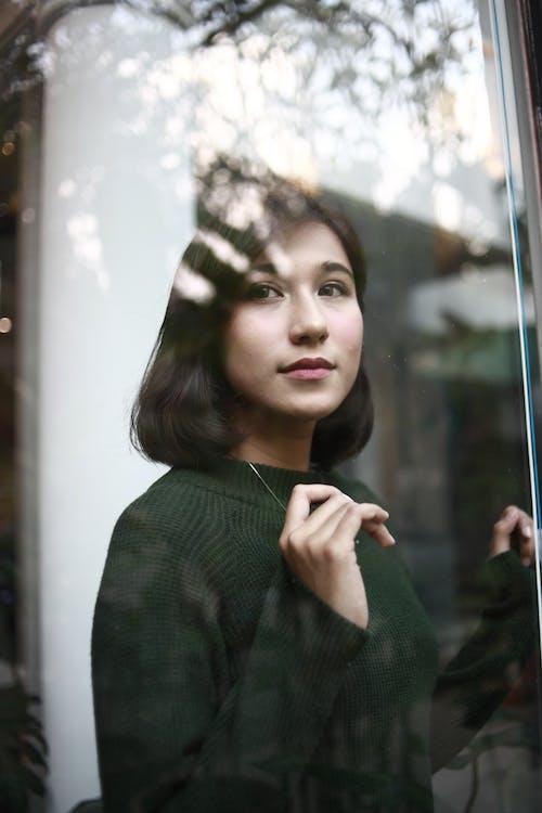 Photo of Woman Wearing Dark Green Sweater