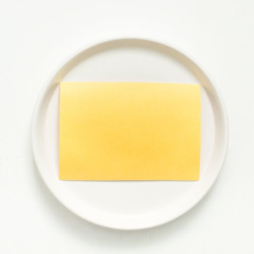 Yellow Sheet on White Round Plate