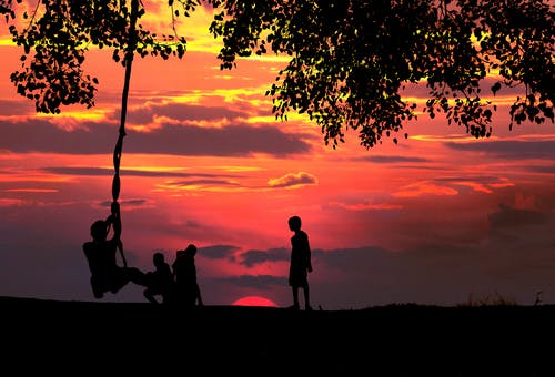 Silhouette Photo of Children Playing