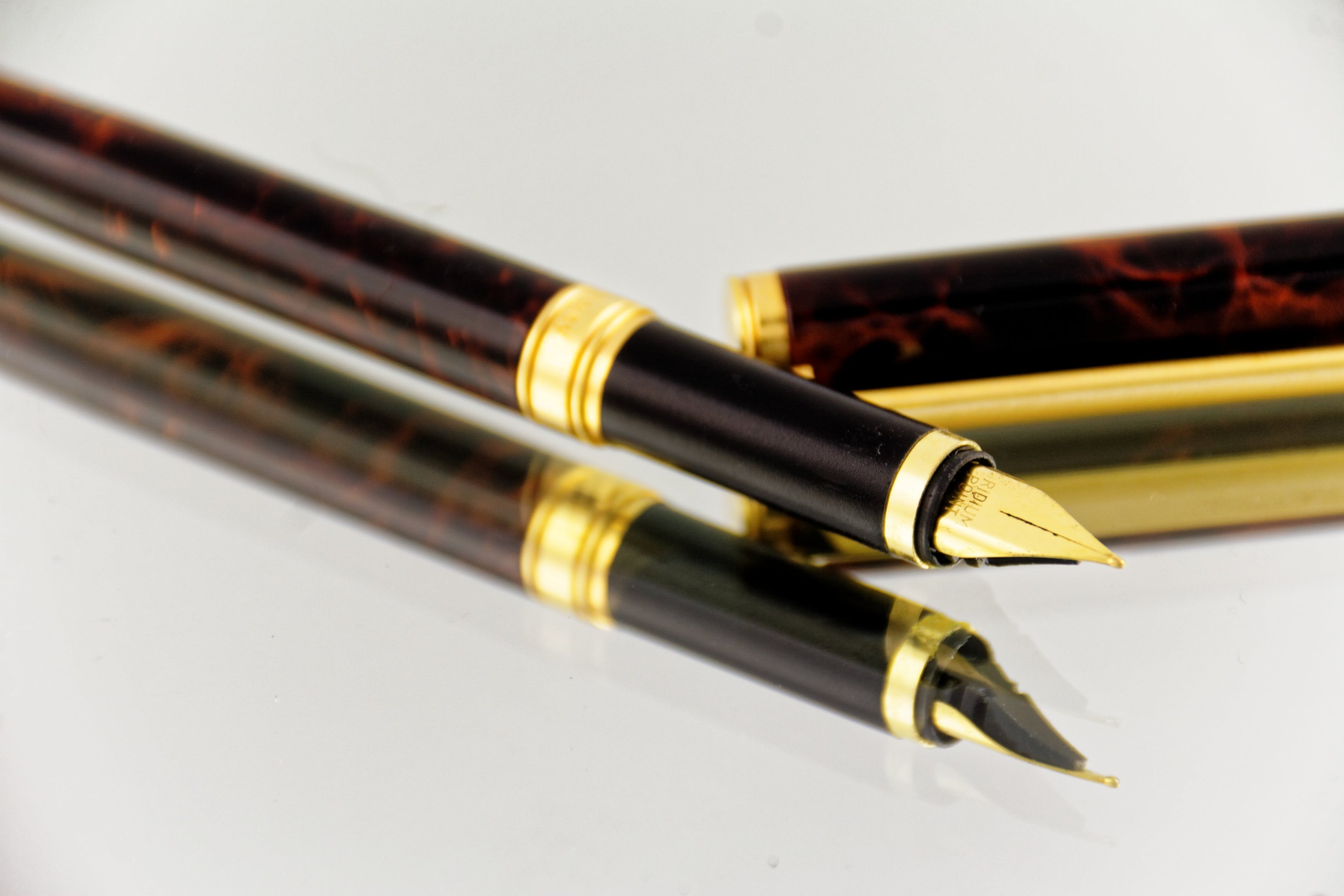 Brown and Black Quill Pen
