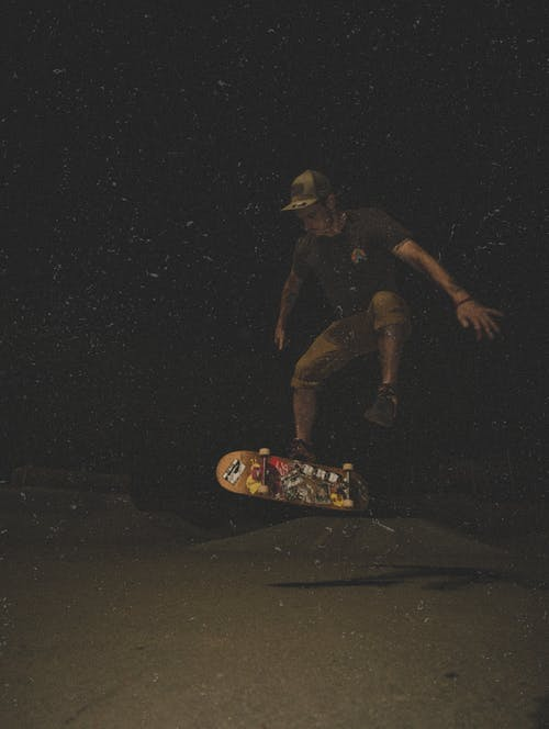 Man Skating At Nighttime