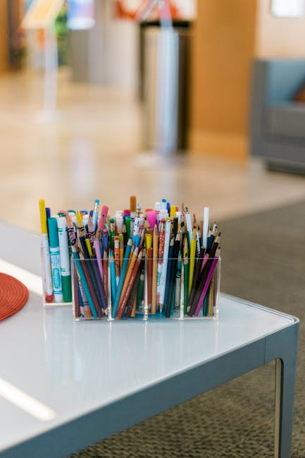 Coloring pencils in organizer on table