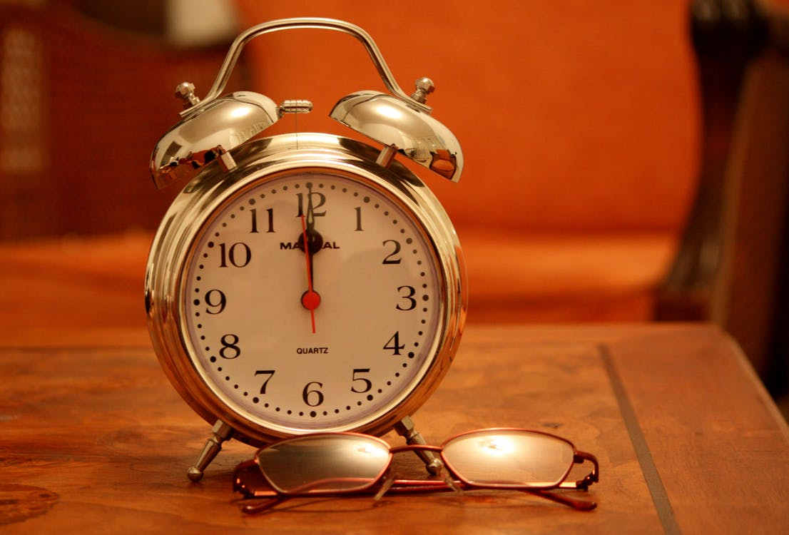 Silver Alarm Clock Displaying 12:00 Time